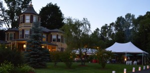 inn with tent at night