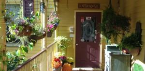 front door with flowers
